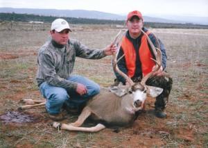 hunters with mule deer