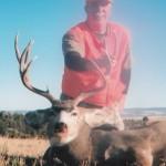 hunter holding a mule deer